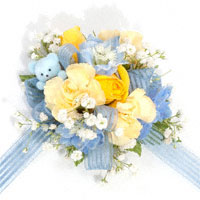 It's A Boy! Corsage #09COR376 Viviano Flower Shop new baby design in blue, yellow, and white flowers with tiny bear