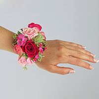 Charming Corsage #17COR407 Viviano Flower Shop arrangement in shades of pink w/real succulent plant