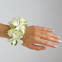 Moonlight Corsage #17COR410 Viviano Flower Shop arrangement in shades white on adjustable cuff bracelet