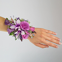 Royalty Corsage #17COR417 Viviano Flower Shop shades of purple with calla lilies  orchids spray roses