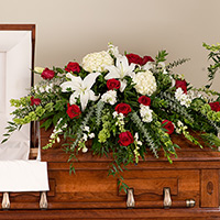 Rose Elegance Casket Spray #199016 Viviano Flower Shop funeral service floral arrangement covering with roses, lilies