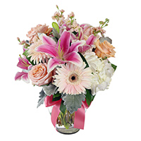 Blush #44217 Viviano Flower Shop floral design in soft pink and cream in a glass vase tied with a ribbon bow