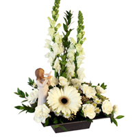 Soar #89715W Viviano Flower Shop sympathy floral design in  white with snapdragons,gerbs, daisies, and Willow Tree figurine
